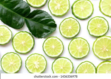 Horizontal slices of fresh Bergamot fruits and green leaf seamless pattern texture for background .Top view,