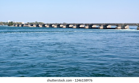 Horizontal of a small service bridge on the Niagara River leading to  Niagara Falls, Ontario on a sunny day