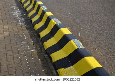 horizontal stripes for traffic signs. highway concrete barriers on the road. vehicle lane separator. yellow color with black stripes. protects pedestrians in a dangerous turn