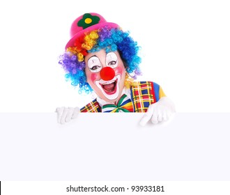 Horizontal studio portrait of a clown pointing to the blank board