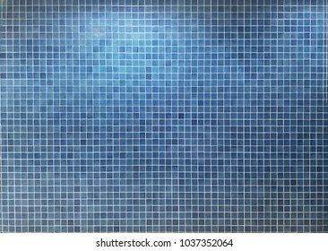 Horizontal surface image of blue mosaic tile wall for background.