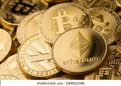 horizontal top view closeup of ethereum litecoin and bitcoin stack of golden coins background texture exchange concept