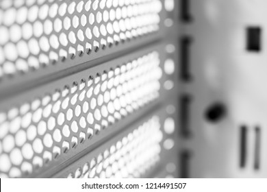 Horizontal ventilation grille. Air vents. Metal construction. Angle view. Black and white tones.