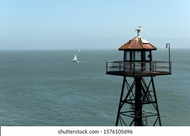 Horizontal  view of the Alcatraz guard tower with a sailing boat on the background