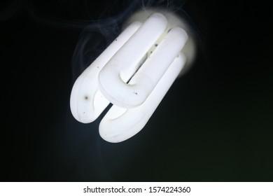 horizontal view of Bulb with misty smoke or white tube light / bulb with smoke or heat bulb or tube light produce smoke