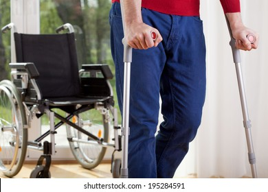 Horizontal view of a disabled man on crutches