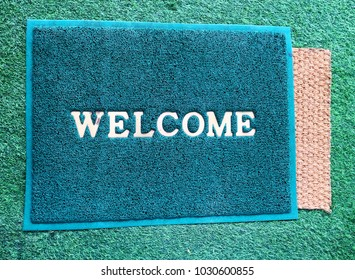 Horizontal view of doormat with welcome text