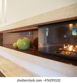 Horizontal view of fireplace inside modern interior