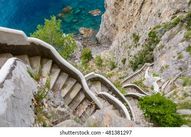 Horizontal view over high stairs in Amalfi Coast in Italy. Lying at the mouth of a deep ravine, Amalfi is a town in the province of Salerno.