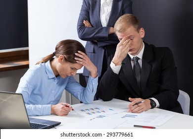 Horizontal view of tired employees during job