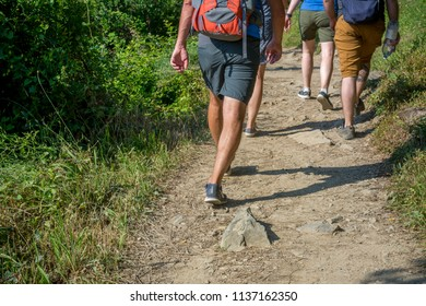 Horizontal View of Tourists Walking in  the  Path in the Mountains  from Vernazza to Monterosso. Italy, National Park of the Cinque Terre