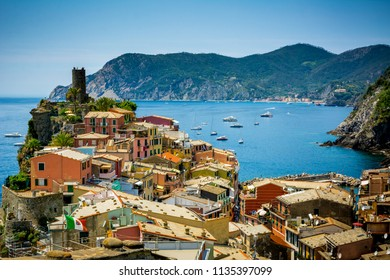 Horizontal View of the Town of Vernazza on blue Sea and the Coastline of the Liguria Background. Italian National Park of the Cinque Terre