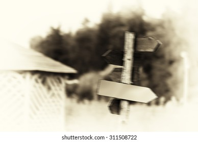 Horizontal vintage sepia right aligned road sign blurred background