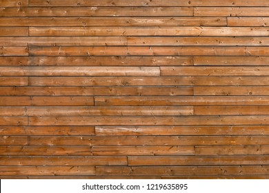 Horizontal wooden texture background. Facade of a log house, copy space. Wooden texture background Wall of blockhouse