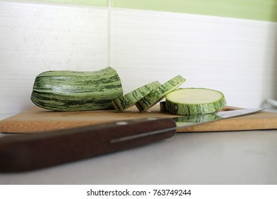 A horizontally oriented picture of a chopped zucchini takes place for text at the top and bottom with a focus on the central zucchini cubes