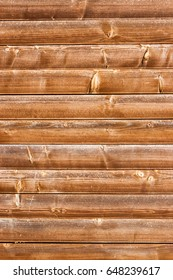 Horizontally tiled stained wood wall texture background.