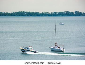 Horka, Slovakia - JUN 03, 2018: water police patrols Zemplinska Sirava lake, Slovakia. two sailboats stand still, safe vacation in summer