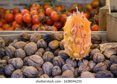 horn melon and walnuts on a market