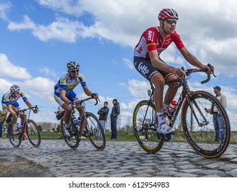 HORNAING,FRANCE-APR 10: The Belgian cyclist Frederik Frison of Lotto-Soudal Team riding in the peloton on a paved road in Hornaing, France during Paris Roubaix on 10 April 2016.