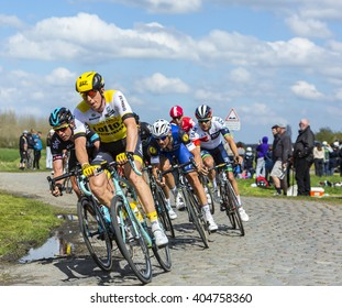 HORNAING,FRANCE-APR 10: The Belgian cyclist Tom Boonen of Etixx-Quick Step Team riding in the peloton on a paved road in Hornaing, France during Paris Roubaix on 10 April 2016.