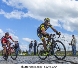 HORNAING,FRANCE-APR 10: The French cyclist Yohann Gene of Direct Energie Team riding in the peloton on a paved road in Hornaing, France during Paris Roubaix on 10 April 2016.