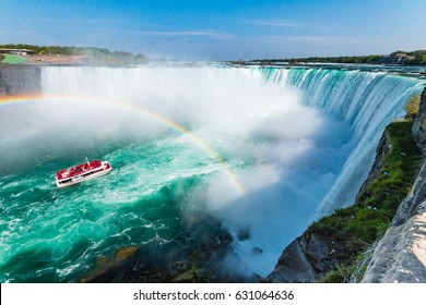 Hornblower Boat Full of Tourists Under Rainbow Sprayed By Horseshoe Waterfall, Niagara Falls, Ontario, Canada