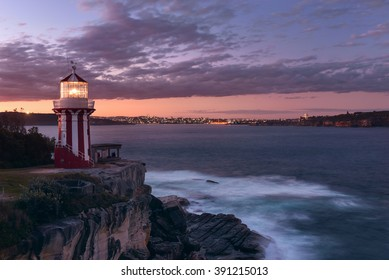 Hornby lighthouse, also known as South Head Lower Light building on a cliff at the entrance to Port Jackson and Sydney Harbour. Located in Watsons Bay. During sunset. Long exposure