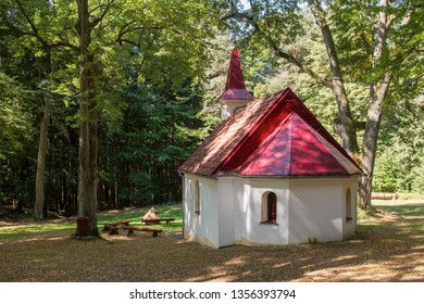 """Horni Paseka, Czech republic - August 29 2015: Forest chapel of the Holy Trinity at """"Krizna studanka"""" pilgrimage site located by a miraculous spring."""