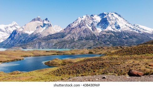 Horns of Towers of the Paine, Patagonia, Chile. At its base blue lake Nordenskjold.