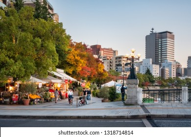 Horoshima, Japan -November 6, 2018: Hiroshima Cityscape at sunset in autumn, with a few shops and take away restaurants on the side of Motoyasu River in Japan close to the Peace Memorial Park.