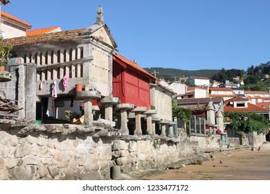 Horreos, traditional galician granary in the fishing village of Combarro. Galicia, Spain