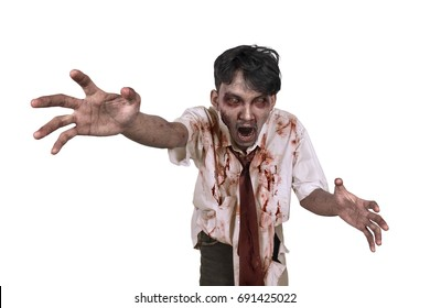 Horrible scary zombie in clothes want to catch you isolated over white background