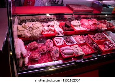 A horrific butcher's display showing sheep's feet, brains, heads, testicles, stomach and liver