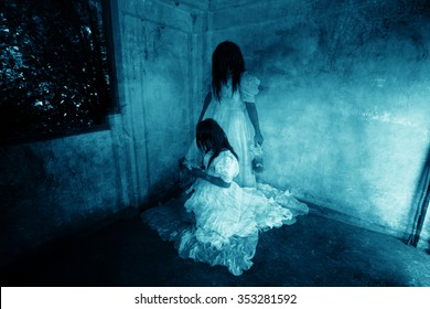 Horror background of Mysterious Twins Woman in White Dress Standing and Sitting in Abandon Building
