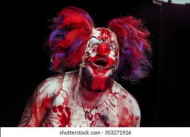 Horror clown. Bloody freak.