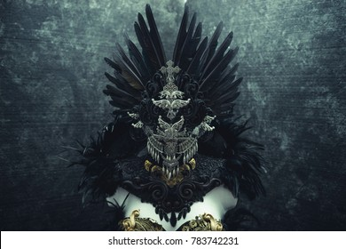 Horror, dark gothic dress formed by a silver metal tiara and a golden corset, handmade costume