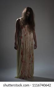 Horror film. A girl in a bloody dress
