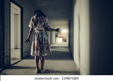 Horror of ghost woman or zombie held the knife. In of the abandoned hospital.