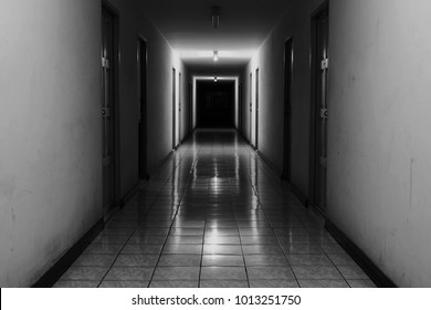 Horror hallway. Dark light from the end of hallway. Scary walkway.
