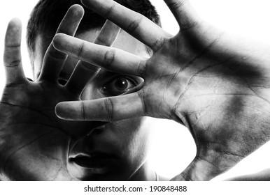 Horror. Man emotionally shocked. Focus point on forward hand