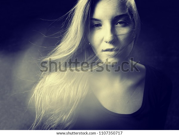 Horror Movie Frame. Spooky female portrait of ghost or demon in dark mist with black eyes
