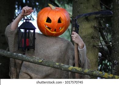 horror pumpkin with a scythe