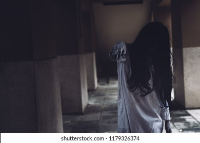 Horror scene of ghost woman death movie halloween festival in the dark house nightmare screaming on hell is monster devil girl or female dead characters at night evil dressing wraith spirit theme.