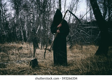 Horror scene. Grim reaper in the wood