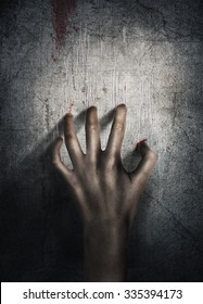Horror Scene. Hand on wall background. Poster, cover concept