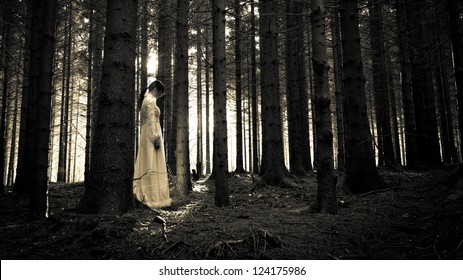 Horror scene - mysterious woman in the forest