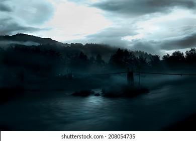 Horror scene of the old rustic bridge over river
