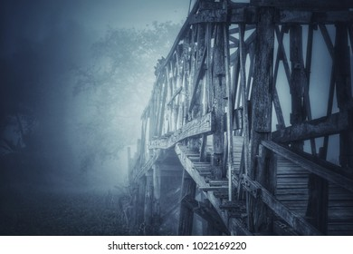 Horror Scene, Old Wooden bridge with the mist, Photo have noise and vignette.