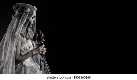 Horror Scene of a Possessed bride Woman in white dress black long hair ghost zombie holding dried Rose Bouquet on hand in dark room isolated. halloween scary concept