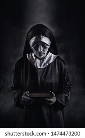 Horror Scene of a Possessed nun Woman with scripture bible textbook and look at camera ghost halloween in dark room